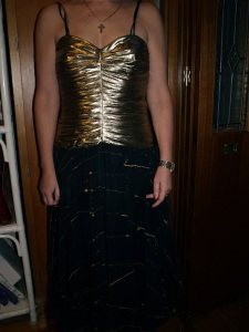 gold and black Anthea Crawford dress before