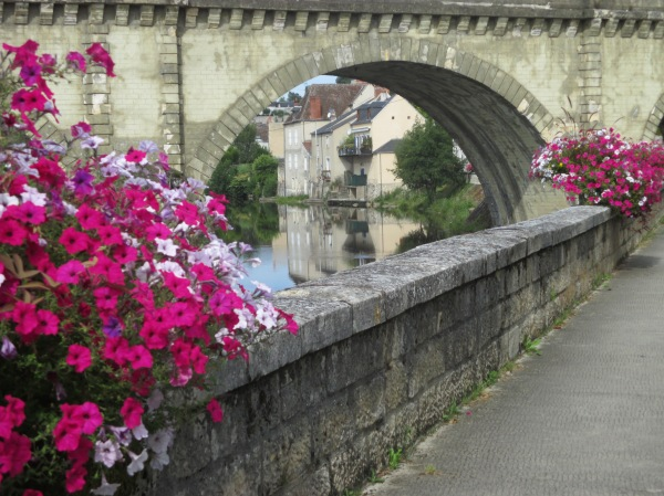 flowers along the Creuse beyond the bridge
